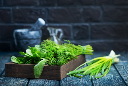 fresh greens in wooden bx and on a table Stock Photo