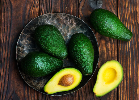 fresh green avocado on the wooden table