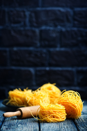 raw noodles from chicken yolks on a table Stock Photo