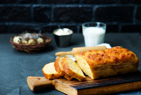 fresh bread on wooden board and on a table