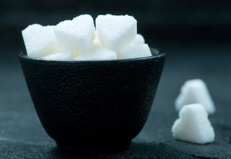 white sugar in bowl on a table Stock Photo