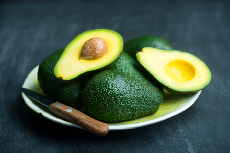 fresh avocado on a table, green avocado