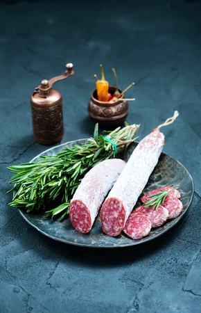 salami with aroma spice on the board