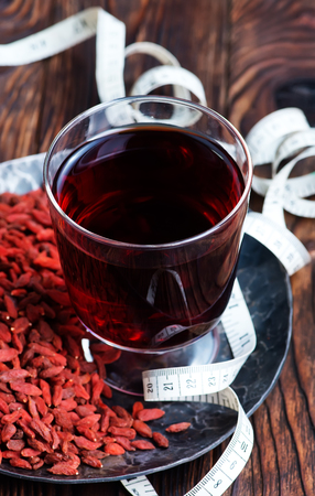 lycium: drink from goji and dry goji on a table