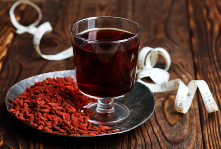 chinese wolfberry: drink from goji and dry goji on a table