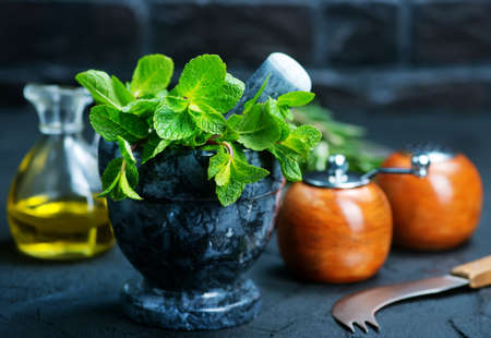 fresh mint in bowl, aroma herb on kitchen table
