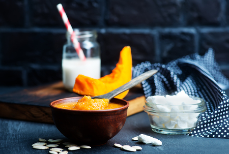 pumpkin porridge in bowl and on a table Stock Photo - 75585372