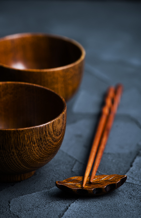 wood bowl with wooden chopsticks on a table Stock Photo