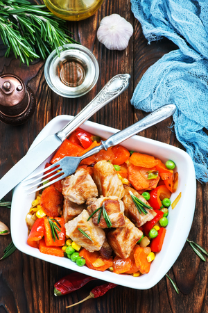 fried meat with vegetables in the bowl