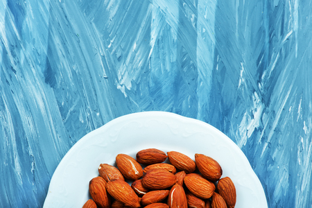 almond on a table, dry almond, nuts on wooden background Stock Photo