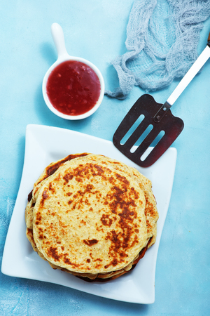 pancakes with honey on the plate Stock Photo
