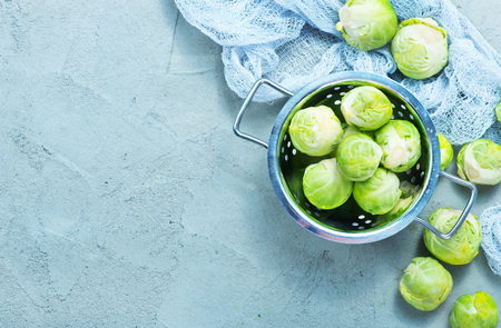 raw brussel sprouts on a table, fresh brussel sprouts
