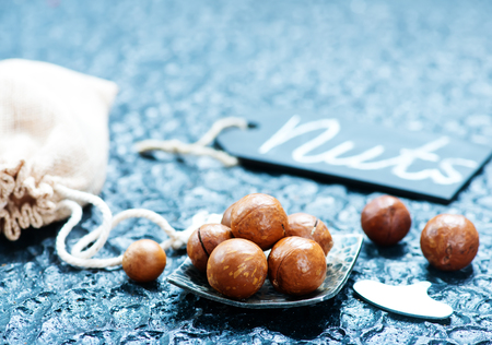 macadamia on a table, dry nuts, stock photo