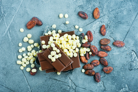 chocolate and cacao on metal plate and on a table Stock Photo