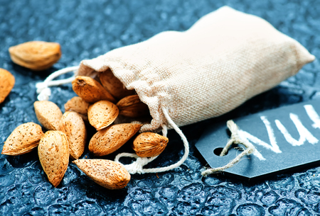 dry almond on the black beton background Zdjęcie Seryjne