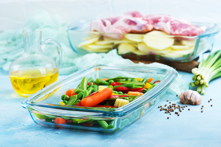 raw vegetables and meat in the glass bowl