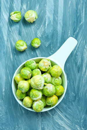 brussel sprouts in bowl and on a table Stock Photo