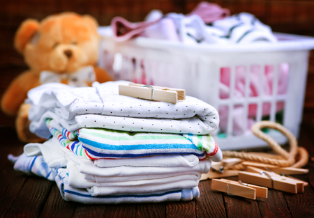 Clear baby clothes on the wooden table
