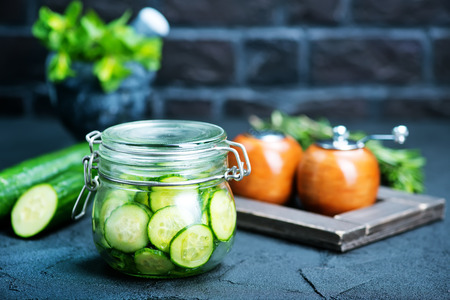 salad with fresh cucumber in glass bank