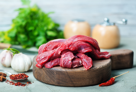 raw meat on wooden board and on a table Stock Photo