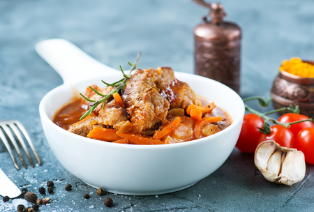 fried meat with tomato sauce in the bowl