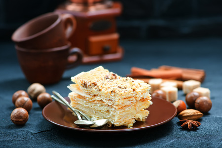 Napoleon tart on plate and on a table Stock Photo
