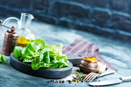corn salad on wooden board and on a table Stock Photo