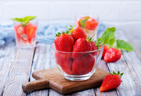 fresh strawberry in bowl and on a table
