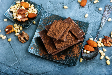 chocolate and nuts on plate, stock photo