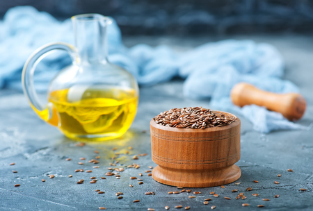 flax seed and oil in glass bottle