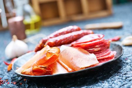 Italian ham, smoked sausages and salami, stock photo