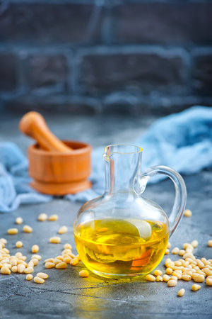 corn oil in bottle and on a table Stock Photo