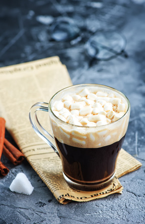 marshmellow: coffee in cup and on a table