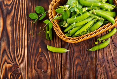 green peas in basket and on a table