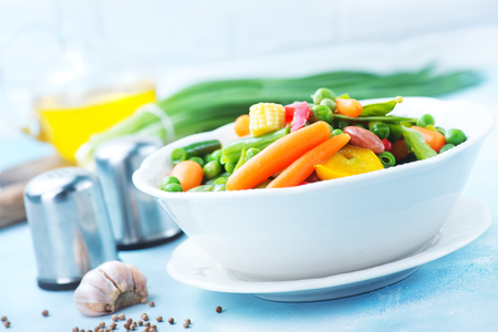 snap bean: mix vegetables in bowl and on a table