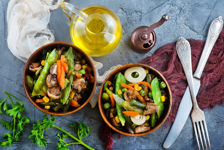 fried mix vegetables in bowl and on a table Zdjęcie Seryjne