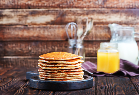 hotcakes: sweet pancakes on plate and on a table