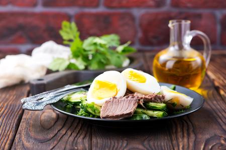salad with tuna on the black plate