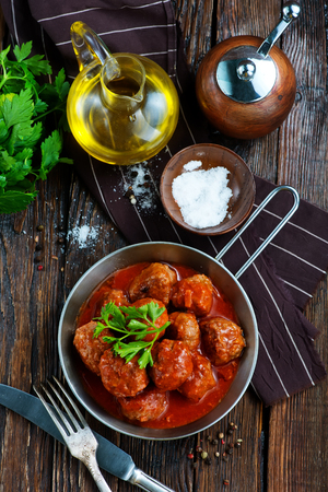 meatballs with tomato sauce in the pan