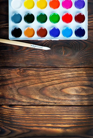 color paint and brushes on a table