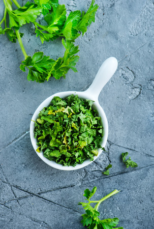 flavouring: dry parsley in bowl and on a table