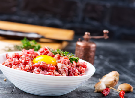 minced meat with salt and spice on a table Stock Photo