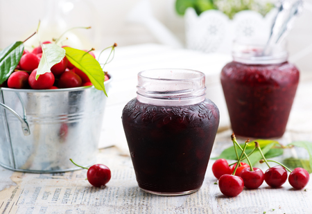 raspberry jam in glass bank and on a table Stock Photo