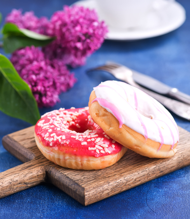 donuts on wooden board and on a table