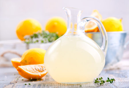 fresh lemon drink in glass jug and on a table Stock Photo