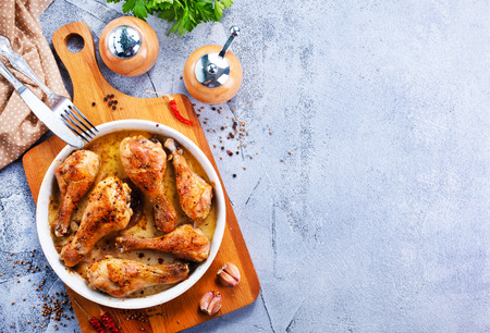 fried chicken legs on plate and on a table Stock Photo