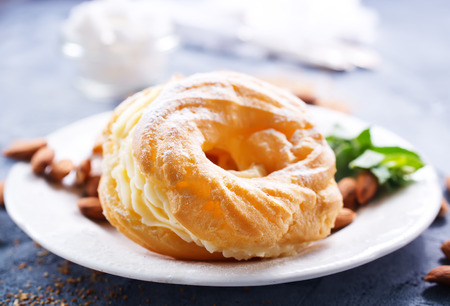 pastry rings with cream on the plate