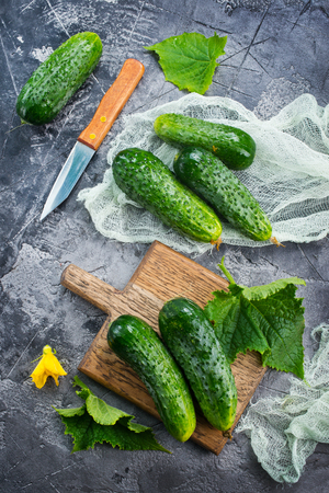 raw cucumbers on a table,stock photo Stok Fotoğraf - 81220720