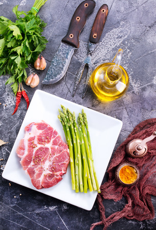 raw meat with asparagus on the white plate Reklamní fotografie