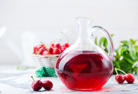 cherry juice in jug and on a table